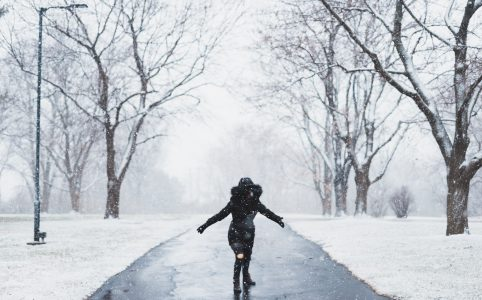 so what is the question this woman is asking in the snow with both hands in front of two trees