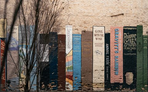 book art mural on wall in Utah with Mark Twain book among other classics