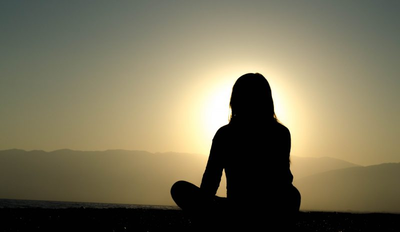 Woman who meditates to enjoy the silence