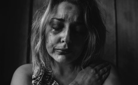 Woman crying with hand on chest - using this to ramble about grief
