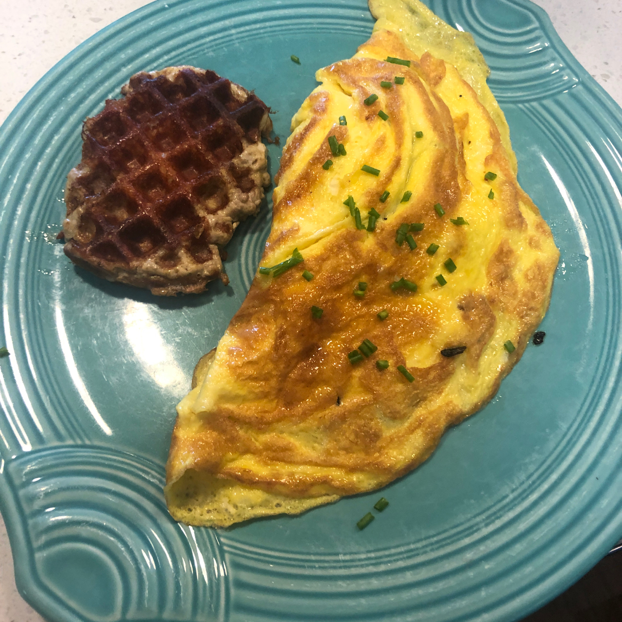 A Carnivore Breakfast of Waffle and Egg Omelet before water only fast