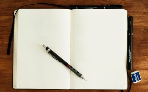 Blank notebook with pen to write without fear