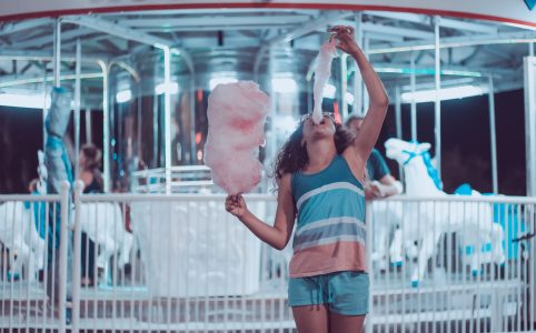 woman spiking her insulin levels eating cotton candy - blog post with quote to remember about anxiety and depression